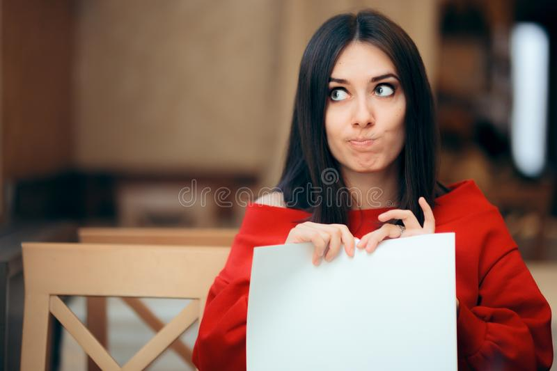 Woman Tearing Up Documents in a Restaurant royalty free stock photos
