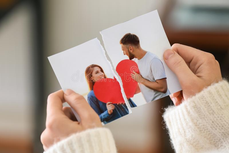 Woman tearing up photo of happy couple, closeup. Concept of divorce stock photos