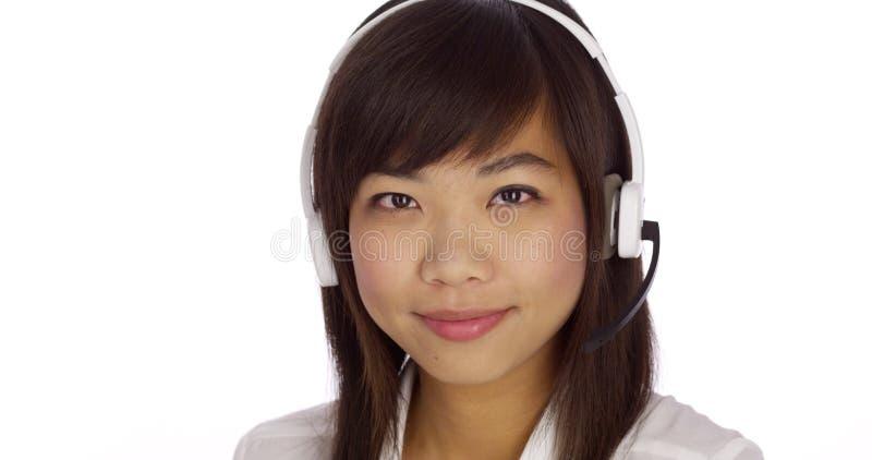 Woman telemarketer looking at camera stock photography