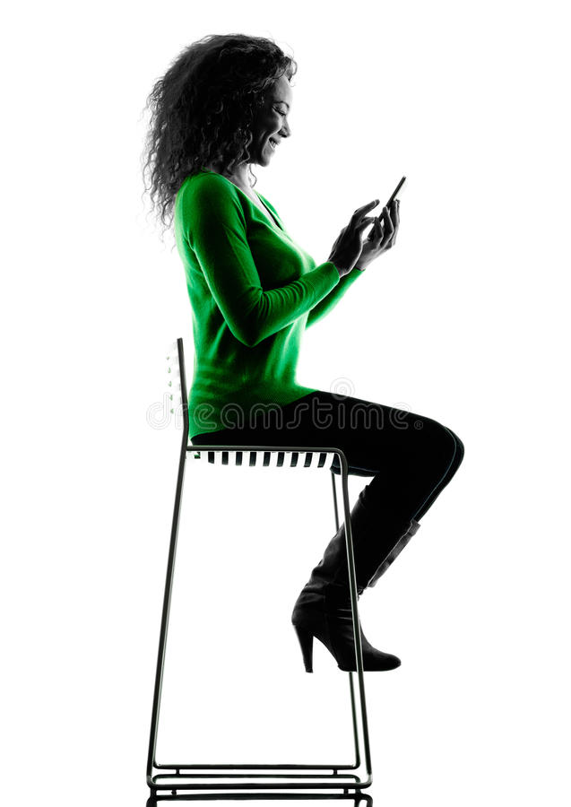Woman Telephones silhouette isolated. One mixed race young woman Telephones silhouette isolated on white background royalty free stock images