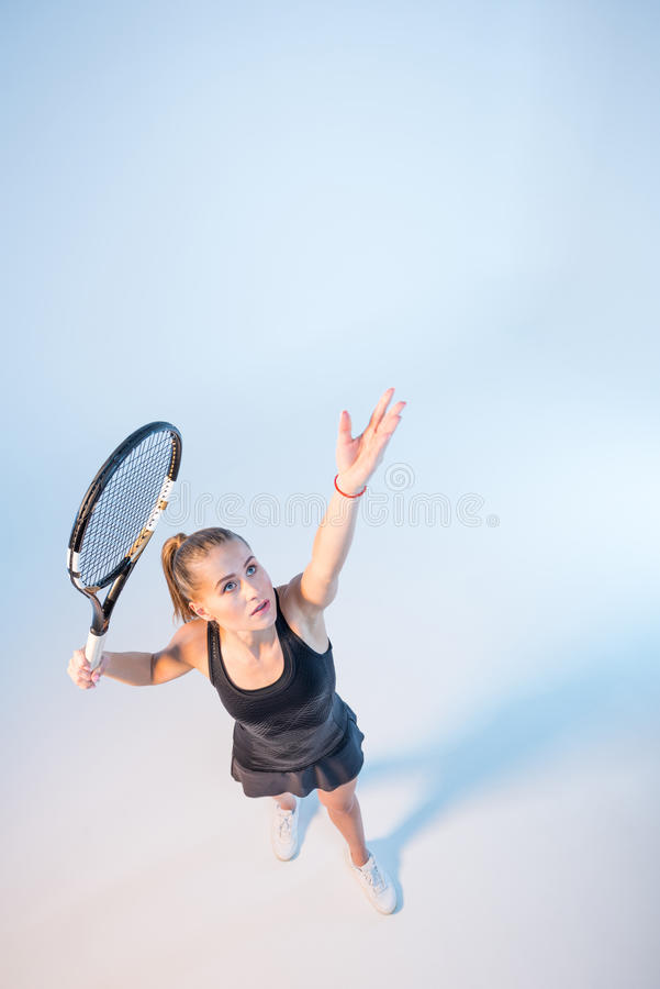 Woman with tennis racket royalty free stock photos