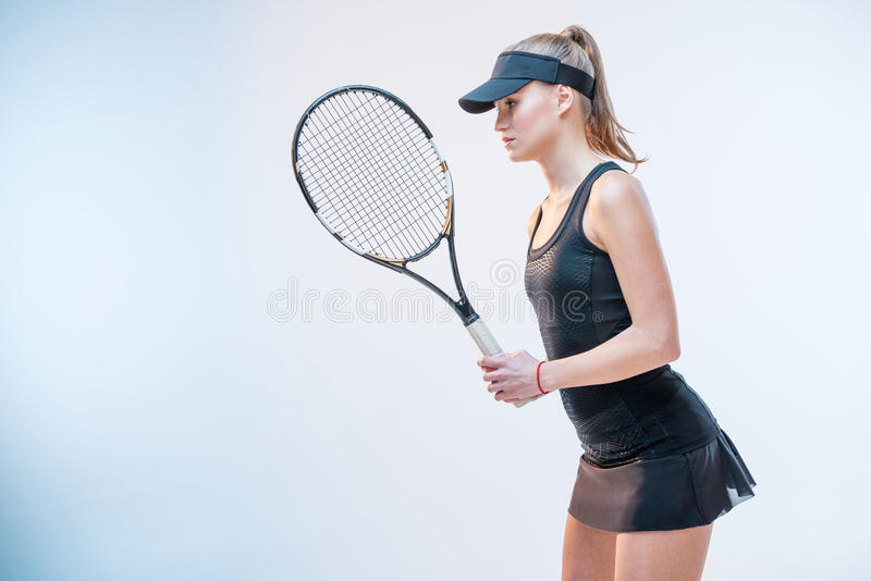 Woman with tennis racket royalty free stock image