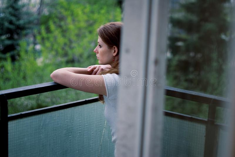 Woman on terrace royalty free stock images