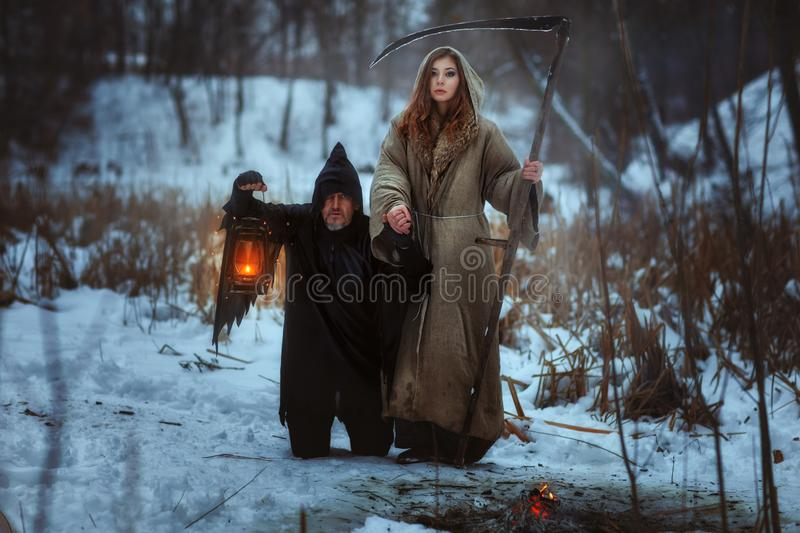 Woman and a terrible dwarf. royalty free stock photo