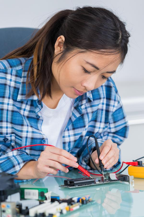 Woman with tester and printed circuit board royalty free stock image