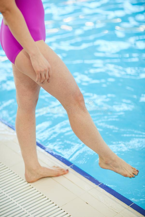 Woman Testing Pool Water stock images