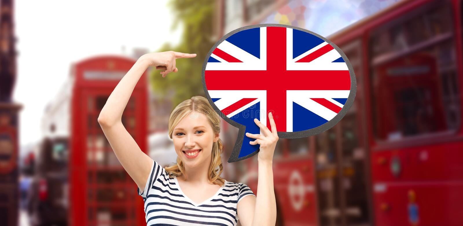 Woman with text bubble of british flag in london royalty free stock images