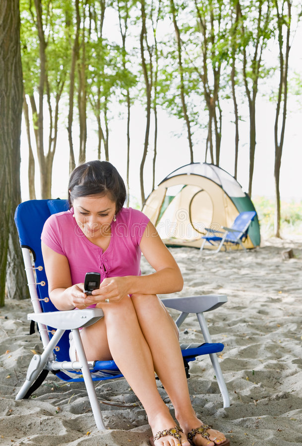 Download Woman Text Messaging On Cell Phone At Campsite Stock Image - Image: 7430531