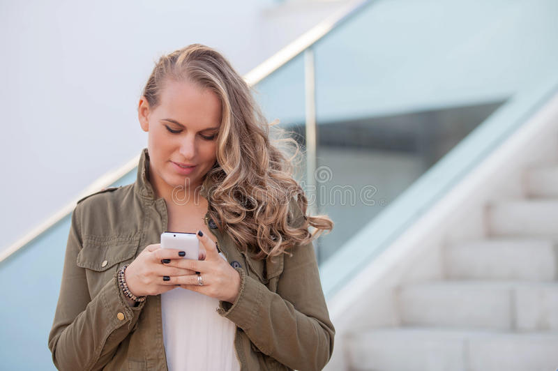 Woman texting on cell or mobile phone stock image
