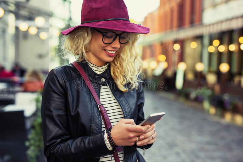 Woman texting on her smartphone royalty free stock image
