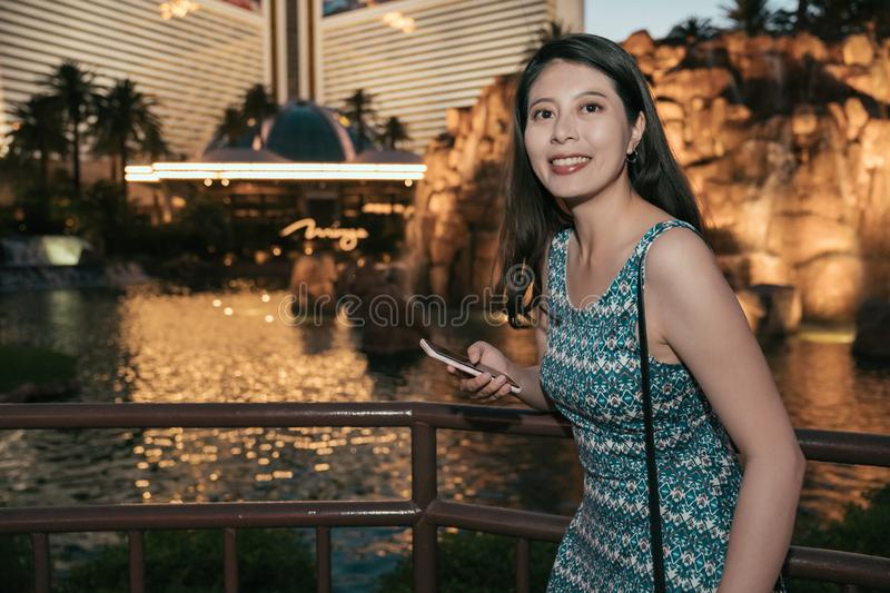 Woman texting messaging text on phone at night royalty free stock photos