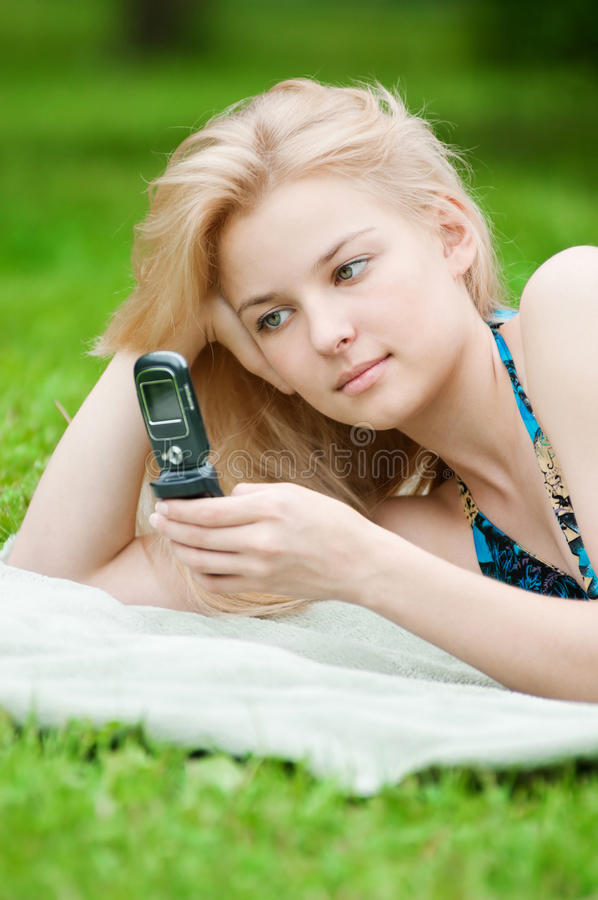 Woman Texting On Mobile Phone Royalty Free Stock Image