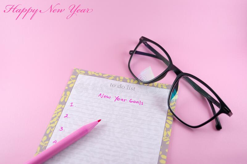 Woman theme happy new year greeting card template on pink background royalty free stock image