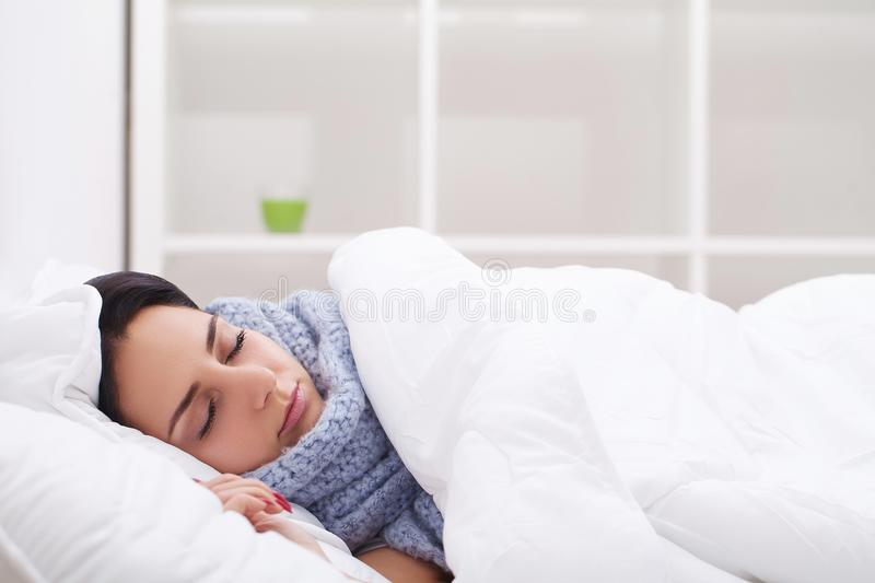 Woman with thermometer sick colds, flu, fever, headache in bed.  stock photos