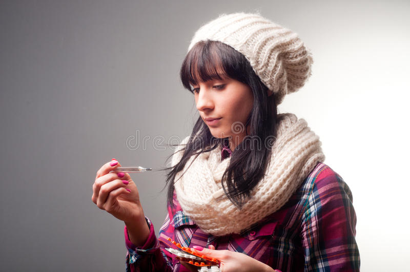 Woman with thermometer sick colds stock image