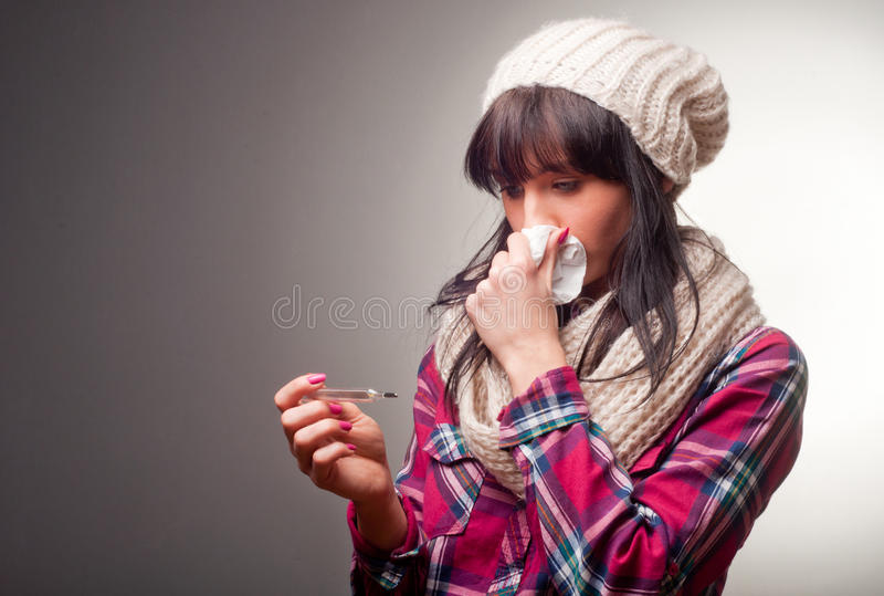 Woman with thermometer sick colds royalty free stock photo