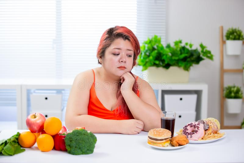 Woman think about healthy food stock photography