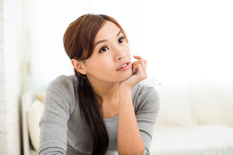 Woman think of something stock photography