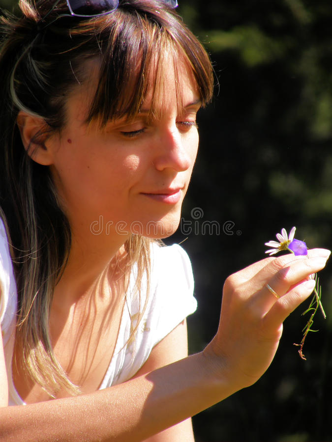 Woman thinking. About flowers and nature stock photos