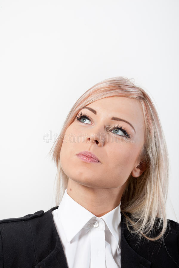 Woman thinking blonde with beautiful blue eyes stock image