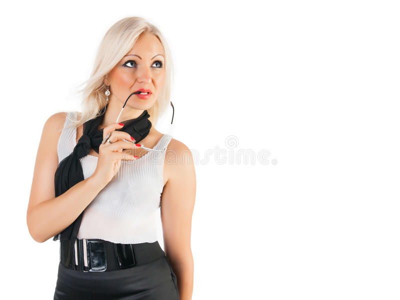 Woman thinking. Businesswoman stands and thinking of something at the white background royalty free stock photos