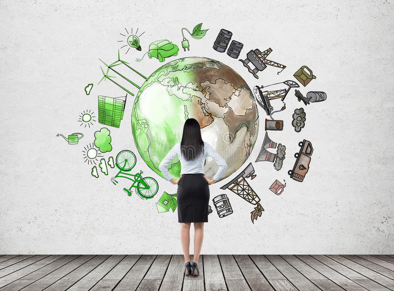 Woman thinking about environment, oil production and ecoenergy i stock photography