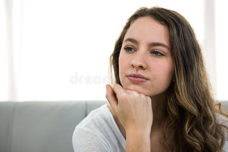 Woman thinking with hand on chin stock photos