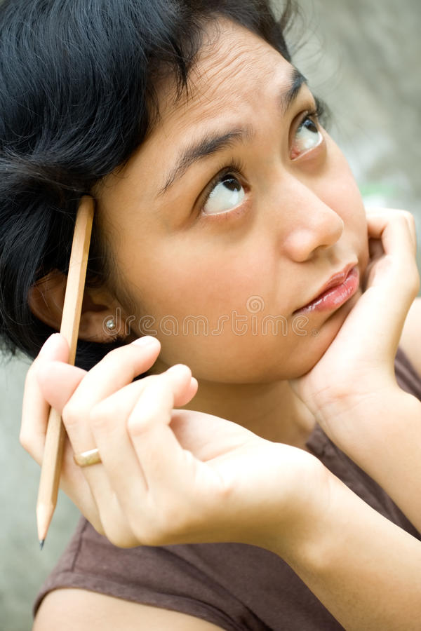 Woman thinking an idea stock images