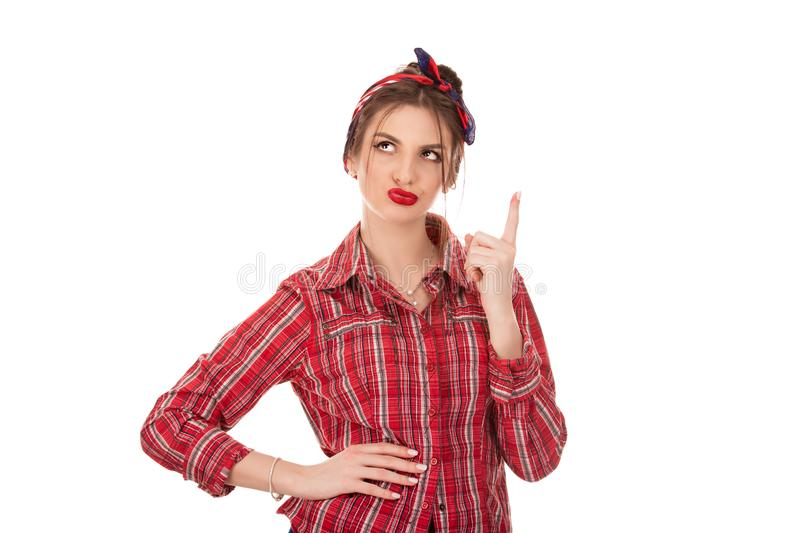 Woman thinking in looking pensive and skeptical. Confused girl. Latin American woman thinking in looking pensive and skeptical in casual clothes red checkered stock photography