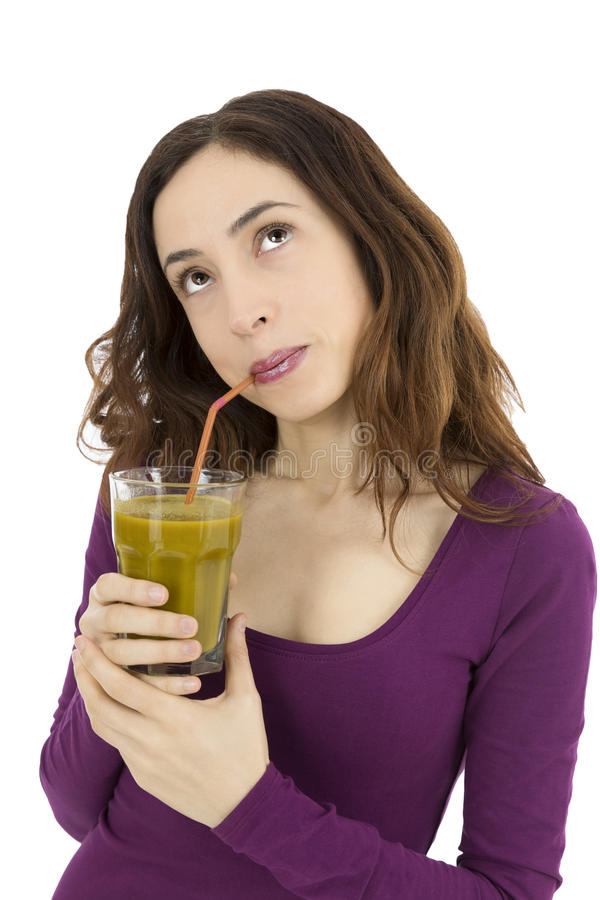 Woman thinking and looking up with a smoothie glass in her hand royalty free stock images