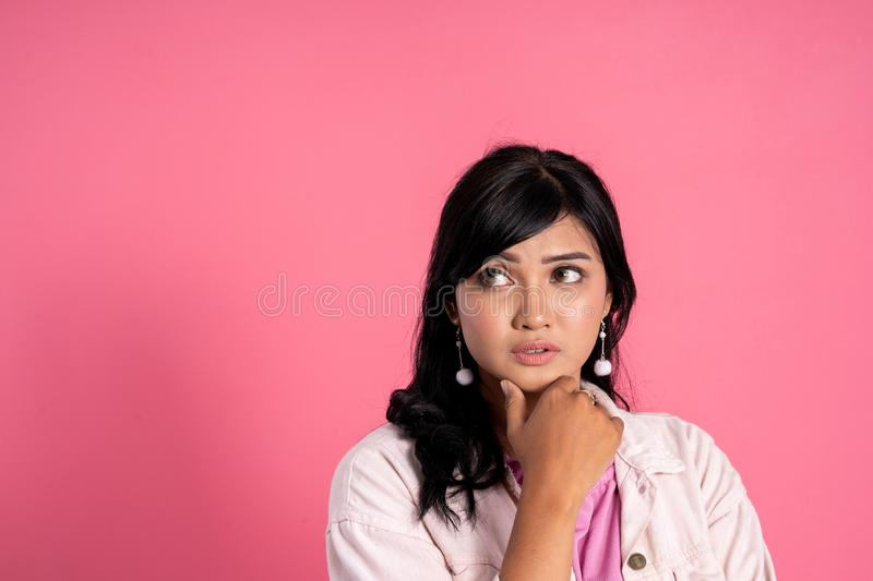 Woman thinking for new idea. Thinking for new idea. attractive woman look up daydreaming against pink background stock images