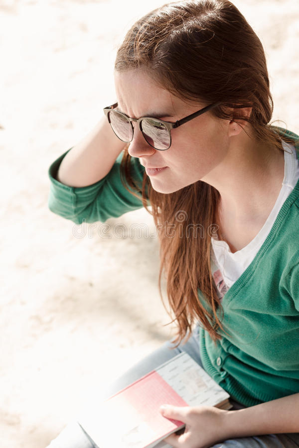 Woman is thinking over the subject of just read book royalty free stock images