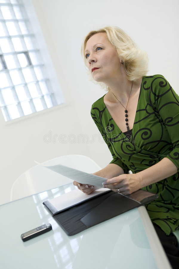 Woman Thinking About Reading Stock Photo