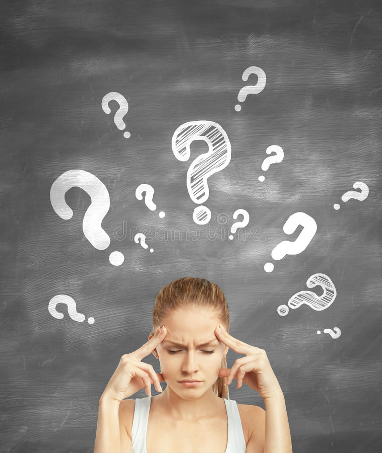 Woman thinking. Woman standing thinking with question mark over head royalty free stock images