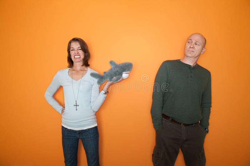 Download Woman Threatens Man With Toy Stock Photo - Image: 19238768