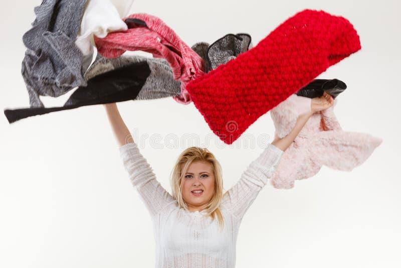 Download Woman Throwing Big Piles Of Clothing Stock Image - Image: 83715587