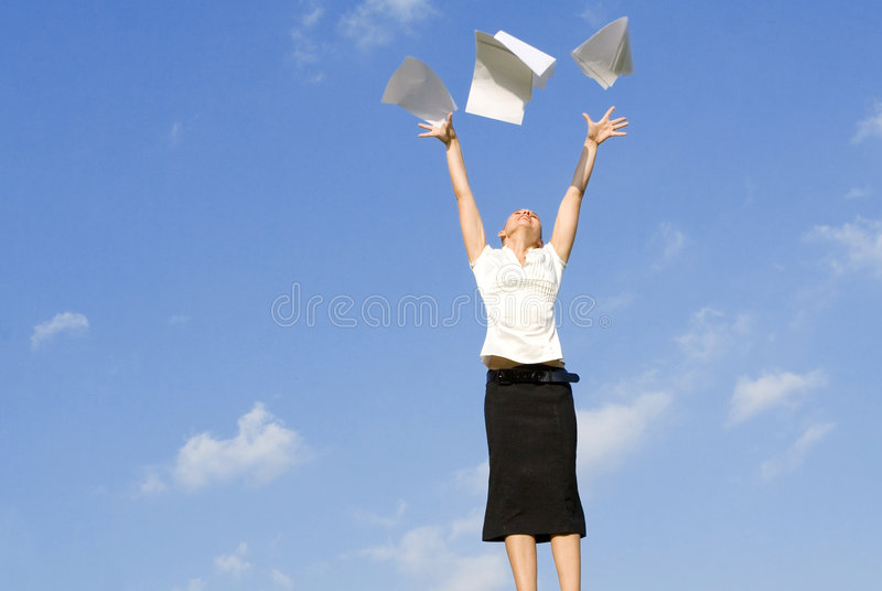 Woman throwing papers in air stock photos