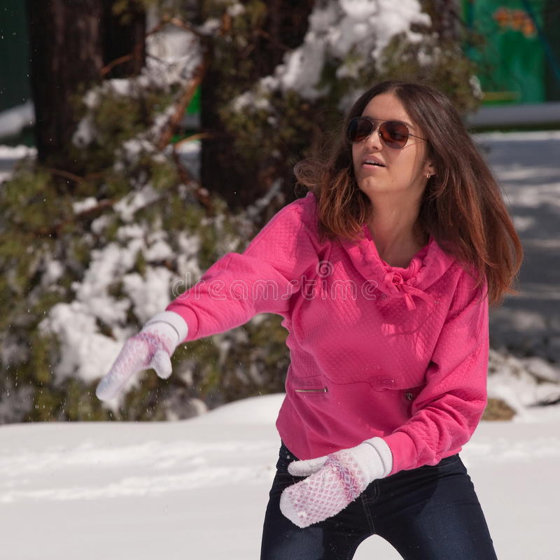 Download Woman throwing snowball stock photo. Image of outdoors - 19382604