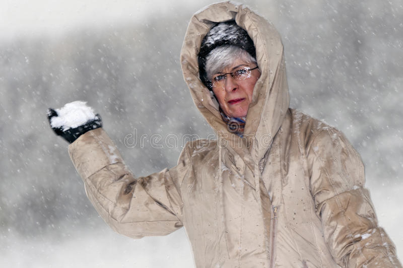 Download Woman throws snowball stock image. Image of flakes, camera - 17585867