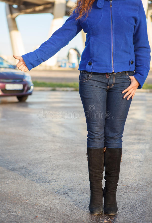 Woman With Thumb Lift On Roadside Royalty Free Stock Photos