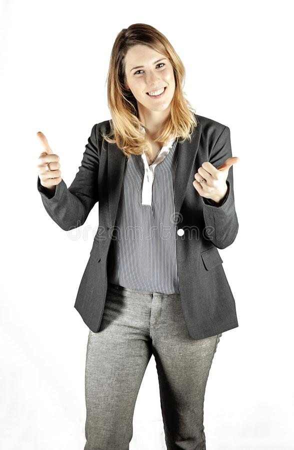 Woman with thumbs up. A portrait of a happy casual clean cut business woman with thumbs up sign, success royalty free stock photography