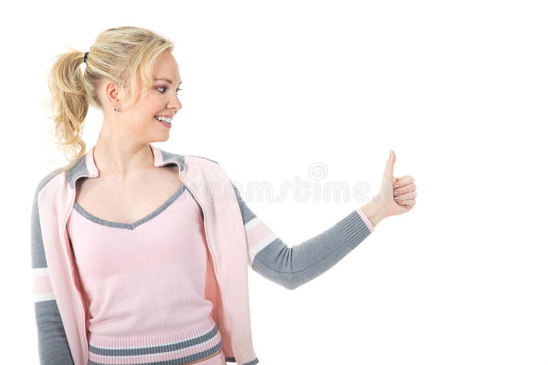 Woman with thump up. Blond young woman with thump up stock images