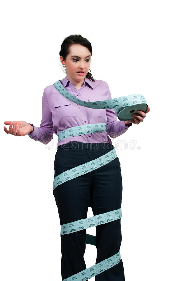 Woman Ticket Taker. Beautiful young woman box office employee wrapped in admission tickets stock image