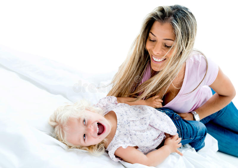 Woman tickling a girl royalty free stock images