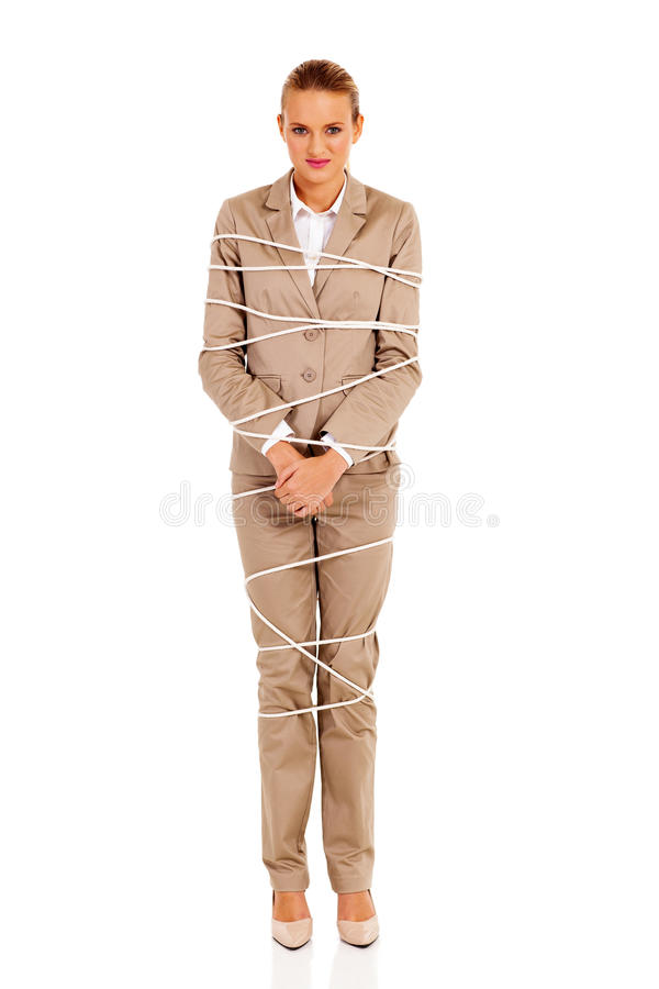 Woman tied up. Young woman tied up by rope isolated on white stock images