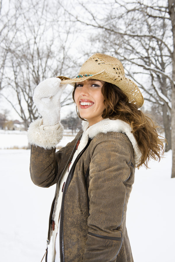 Woman tilting cowboy hat. royalty free stock photography