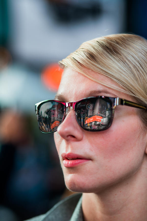Woman with Time Square Buildings Reflection in Sunglasses at Night, stock photography