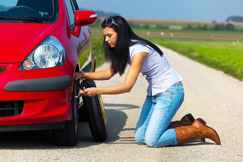 Woman with a tire breakdown in car stock photos