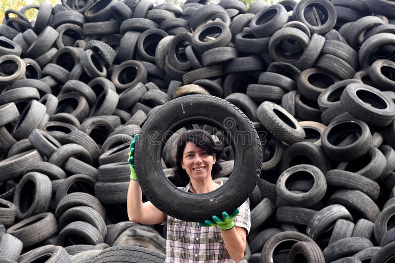 Woman in a tire recycling plant stock photography