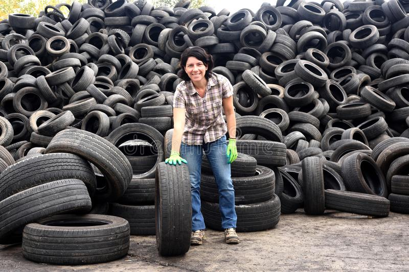 Woman in a tire recycling plant royalty free stock photos